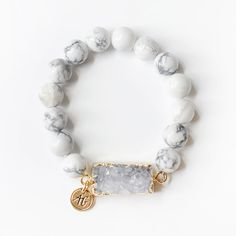 We're all about layering jewels and believe more is more so layer them with your favorite AG pieces! This bracelet is made with high quality elastic and is adorned with our signature gold AG charm. Th