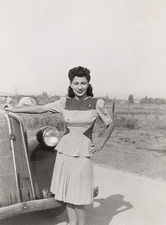 Young woman, 1940s - I love the way the different coloured panels in the sides, give shape to her waist.