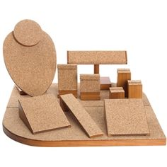 "Cork set - This cork display set creates a warm, textured arrangement for your jewelry.12 Piece natural cork display set includes:Two 4"" W x 2"" H x 4-3/4"" LOne 2-3/8"" W x 3-5/8"" H x 1-5/8"" LOne 1-1/2"" W x 7-7/8"" H x 1-5/8"" LOne 2-1/4"" W x 2-5/8"" H x 1-5/8"" LOne 7-1/4"" W x 4-3/8"" H x 2-3/4"" LOne 1-1/2"" W 1-7/16"" H x 1-5/8"" LOne 1-1/2"" W x 2-1/4"" H x 1-1/2"" LOne 1-1/2"" W x 3"" H x 1-1/2"" L"