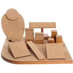 "Cork set-This cork display set creates a warm, textured arrangement for your jewelry.<div><br /></div><div>12 Piece natural cork display setincludes:<div>Two 4"" W x 2"" H x 4-3/4"" L</div><div>One 2-3/8"" W x 3-5/8"" H x 1-5/8"" L</div><div>One 1-1/2"" W x 7-7/8"" H x 1-5/8"" L</div><div>One 2-1/4"" W x 2-5/8"" H x 1-5/8"" L</div><div>One 7-1/4"" W x 4-3/8"" H x 2-3/4"" L</div><div>One 1-1/2"" W 1-7/16"" H x 1-5/8"" L</div><div>One 1-1/2"" W x 2-1/4"" H x 1-1/2"" L</div><div>One 1-1/2"" W x 3"" H x 1-1/2"" ..."
