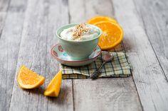 ストックフォト : Bowl of orange curd creme with popped quinoa