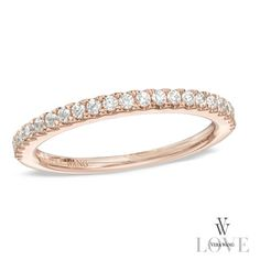 Micro-set into a ribbon of precious 14K rose gold.