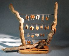 This jewellery holder shows earrings we have handmade using wood, antler, feathers, etc.