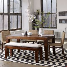 Carroll Farm Dining Table from West Elm. Love this look...awesome contrast between the rustic farm table and the modern black and white rug!