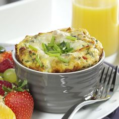 """Individual Italian Frittatas - The Italian word """"frittata"""" refers to frying the egg-based dish in a skillet. This Italian spin with added salami, roasted sweet peppers and mozzarella is baked in a ramekin but the ending is the same - delicious day or night."""