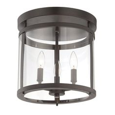 Cast a warm glow over your living room or den with this 3-light semi-flush mount, showcasing a sleek cylindrical design for a touch of traditional appeal.