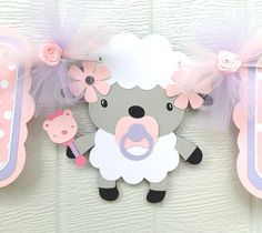 Its a girl lamb baby shower banner in pink  I want this for my shower and would love to have the Invitations to match it