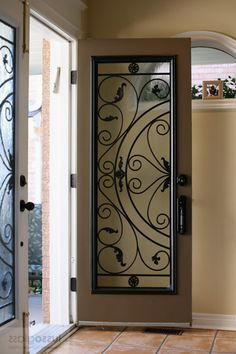 Ultimate Iron Doors Wood Everything You Need To Know . Storm Doors With Screens, Iron Front Door, Wrought Iron Doors, Diy Plant Stand, New Builds, Wood Doors, Entrance, Interior Design, Gates