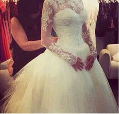 Lace sleeves are a beautiful choice for a winter wedding