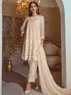 Subtle cream partywear straight cut suit online which is crafted from georgette fabric with exclusive embroidery work. This stunning designer straight cut suit comes with santoon bottom and chiffon with heavy work dupatta. Manish Malhotra Salwar Kameez, Indian Dresses, Indian Outfits, Heavy Dupatta, Salwar Kameez Online Shopping, Women's A Line Dresses, Georgette Fabric, Gowns Online, Designer Wear