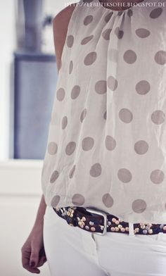 Not a fan of the blingy belt, but love the skinny jeans with the polka dots!