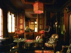 "The upstairs hall at ""Cow Hollow"" was reached via an exterior spiral staircaseand was decorated the room with 19th Century English Regency Chinoiserie bamboo panels and 18th century French and English furniture."