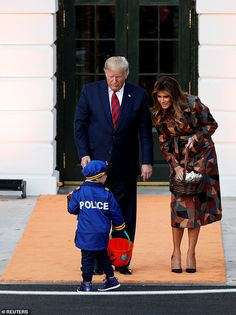 Melania Trump definitely got everyone's attention Monday when she stepped out in a gorgeous patchwork leather coat for the Halloween party at the White House. Kate Bennett, Yellow Plaid Skirt, Donald Trump Family, Kids Dress Up, First Lady Melania Trump, Usa Today Sports, Fall Looks, Looking For Women, Halloween Party