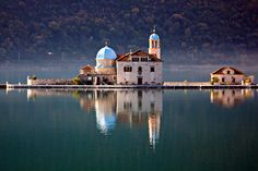 Kotor, Montenegro His shows peaceful waters around the island of Our Lady of the Rocks near Perast