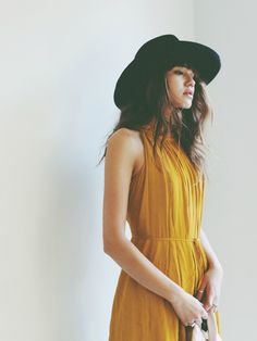 Spotted: Natalie Off Duty channeling spring vibes in her mustard pleated halter dress & wide-brim hat