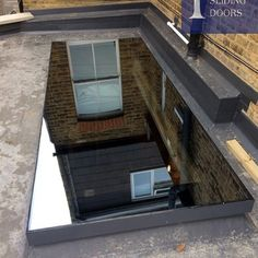 Lightwell & Lean-to Roofs · 1st Folding Sliding Doors House Extension Design, Roof Extension, Roof Design, House Design, Flat Roof Skylights, Ridge Roof, Lean To Roof, Roof Lantern, Roof Light