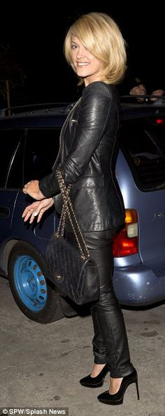 Looking great: The dancing star wore an understated but sexy outfit, teaming leather pants with a matching jacket