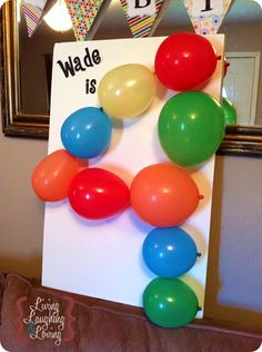 fun, inexpensive birthday decoration. I'd let each guest pop a balloon before they leave b/c what's more fun than popping balloons?!