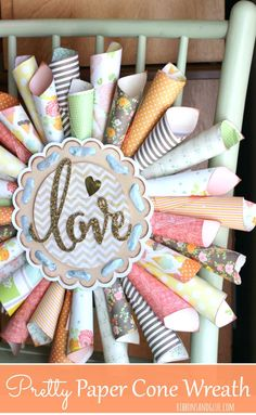 Paper Cone Love Wreath made out of scrapbooking paper and gold glitter die cut. #papercrafts #paperconewreath