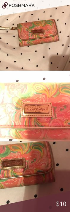 Lilly Pulitzer Wallet Used a few times. Fabric slightly worn, but no rips or tears. Gold plating slightly worn, but still in good condition. Features gold leather strap, two inside pockets, a zipper pouch, & a card holder. Snap closure. Lilly signature engraved on front. All Nighter print. Lilly Pulitzer Accessories Key & Card Holders