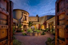 Beringer - mediterranean - exterior - phoenix - Beringer Fine Homes.. Love the rustic doors, opening up to the courtyard...