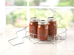 Ball's Home Canning Rack is a strong, durable steel rack – with chrome plating to resist corrosion. Superior design fits Ball jars of any size – small jars no longer fall out and seven quart-size jars fit easily.