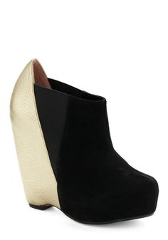Gold and black wedge platforms. I would fall all over the place but these are awesome shoes.