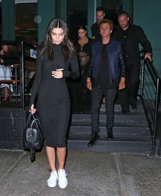 Kendall Jenner on the streets of New York City with Jonathan Cheban & her sisters on Sept. 11 in a black dress and white sneakers.