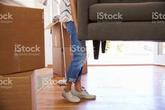 Close Up Of Woman Carrying Sofa Into New Home On Moving royalty-free stock photo