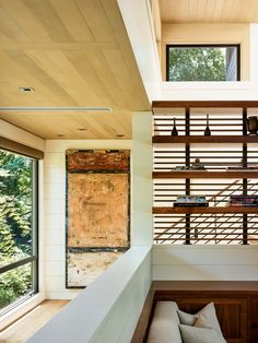 A modern interior with a light wood ceiling.