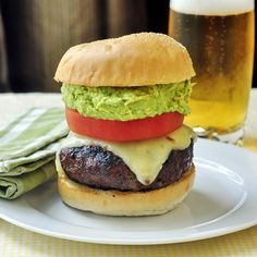 Chorizo Pepper Jack Cheeseburgers with Guacamole - adding some chorizo sausage to your ground beef mix is a fantastic way to infuse great flavor into grilled burgers. The pepper jack cheese and guacamole pump up the deliciousness even more in this amazing cheeseburger.