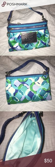 Coach wristlet/clutch Discontinued Coach C's poppy wristlet/clutch. Only used once! No trades Coach Bags Clutches & Wristlets