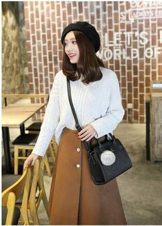 Casual Stylish Woman With Black Crossbody Bag with Furball- Side View Casual Chic, Fur Casual, Womens Messenger Bag, Crossbody Bag, Black Crossbody, Polished Look, Black Cross Body Bag, Timeless Fashion, Fashion Bags