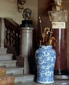 awonderfulpalmettolife:  decordesignreview:  Walking sticks in a large blue and white Chinese vase, surrounded by busts, in the West Entrance Hall - the private entrance to Chatsworth  (via TumbleOn )