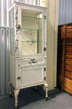Amazing vintage medical / dental / pharmacy cabinet w/ 3 glass shelves, beautiful cabriole legs & casters! original paint! on Etsy, $1,846.05 CAD
