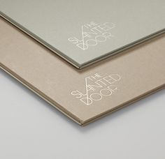 Logo and menu with copper foil print finish and fabric cover for Vietnamese restaurant The Slanted Door designed by Manual