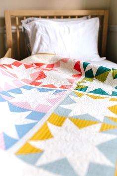 Colorful, modern baby quilt - Stars Hollow Quilt pattern. Fat quarter friendly quilt pattern!