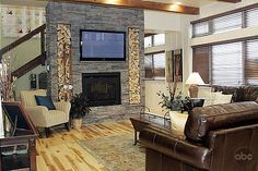 Extreme Makeover: Home Edition - TV.com...  That looks like my couch and I like this room - not the fireplace as much.