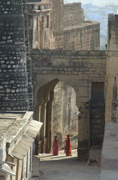 two women in an archway of mehrangarh fort, jodhpur, india