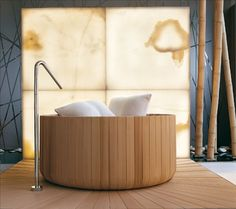 Puntoacqua's Natural ... finished in Canadian cedar, the aptly named Natural bath boasts an organic round shape that can be made to your size specifications. This deep tub invites you to sit and soak away your cares, and you get to do it in style! With wood being such a hot finish and accessory option for the bathroom, this tub makes a great addition to any spa at home.