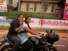 "india girls on bike welcomes-Women empowerment-Save A Girl Child-""Beti Bachao-Beti Padhao"" : indian lady riding pulsur bike"