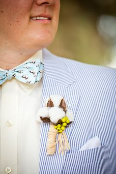 Cotton boutonniere, striped suite and cotton patterned bow-tie.