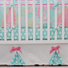 Aqua and pink crib bedding.