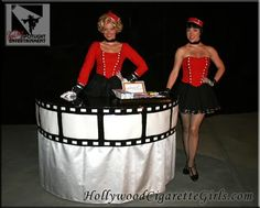 Old Hollywood themed strolling table and vintage cigarette girl Vintage Hollywood, Classic Hollywood, Bugsy Malone, Cigarette Girl, Wine Parties, Pin Up Style, Red Carpet, Peplum Dress, Tables