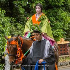 Colorful junihitoe, beautiful ladies on horse back at the Aoi Matsuri (葵祭) 2014 in Kyoto City! They are called Munanori Onna (騎女) and they are the escort  for the Saiō-Dai (斎王代) Princess. #AoiMatusri,  #Kyoto, #SaiōDai, #ShimogamoShrine, #下鴨神社, #MunanoriOnna