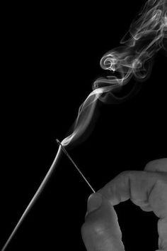 Black and white; smoke; needle; thread; sewed; photography; art.