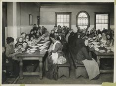 Immigrants being served a free meal at Ellis Island. New York, 1902-1913. NYPL Digital Gallery.