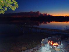 Lake Hudson, Boundary Waters, Minnesota, 2011.  Before the forest fire came.  You can see the smoke of it on the horizon.  Our domesticated fire is well behaved.