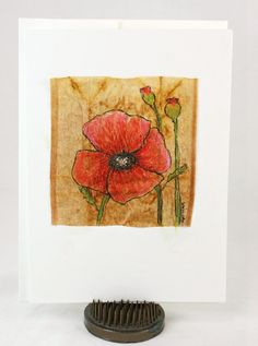 Poppy on Tea Bag, by Judy Applegarth  This is an original, not a print. The poppy was drawn and painted on a tea bag. This unique original, one of a kind handmade greeting card is perfect for any occasion, birthday or just to say you care. Each of my art cards is an original and no two are alike. Cards are drawn on a 5x7 watercolor card base. The inside of the card is left blank so you can write your own personal message. Its size also makes it perfect for framing. Would look nice framed to…