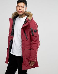 Get this Nicce London's parka now! Click for more details. Worldwide shipping. Nicce London Polar Parka With Faux Fur Hood - Red: Parka by Nicce London, Midweight woven fabric, Quilted lining with internal pocket, Fleece-lined hood, Faux-fur trim, Zip opening, Press-stud closure, Functional pockets, Drawstring waist, Regular fit - true to size, Dry clean, 100% Polyester, Our model wears a size Medium and is 6'0�/183cm tall.  (parka, parka, anoraks, anorak, chaqueta larga, parka, parla…